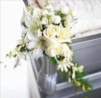 Elegant Remembrance Casket Adornment by US Funeral Flowers