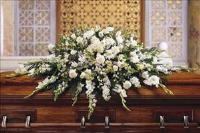 Deluxe Pure White Casket Spray by US Funeral Flowers