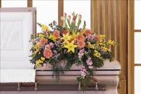Blooming Glory Casket Spray by US Funeral Flowers