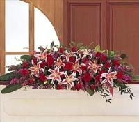 Amethyst And Ruby Casket Spray by US Funeral Flowers