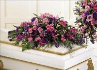 Blanket of Flowers™ Casket Spray by US Funeral Flowers