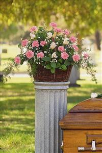 Basket with Pink Flowers by US Funeral Flowers
